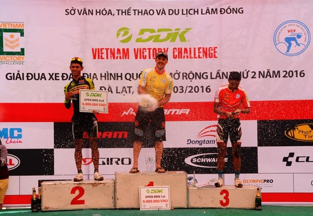 Cory Wallace (C) on the podium at the Vietnam Victory Challenge mountain bike racing in Da Lat on March 13. Photo: Van Bau