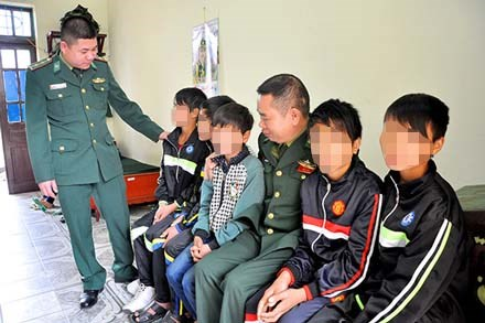 Five of the nine Vietnamese children at a border guards station in Quang Ninh. Photo credit: Quang Ninh Online