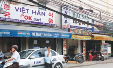 Korean restaurants and shops on Ho Chi Minh City's Thang Long Street. Photo: Hoang Tuan