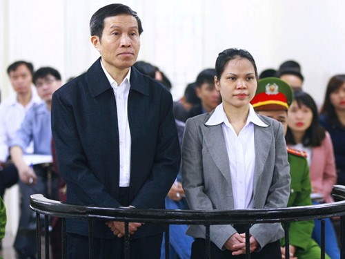 Nguyen Huu Vinh, 60, and Nguyen Thi Minh Thuy, 36, stands trial in Hanoi on March 23, 2016. Photo: Doan Tan