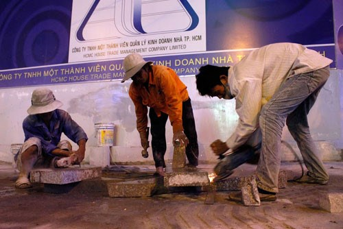 Workers paving a sidewalk with granite on Dong Khoi Street in Ho Chi Minh City. Photo: Tan Phu