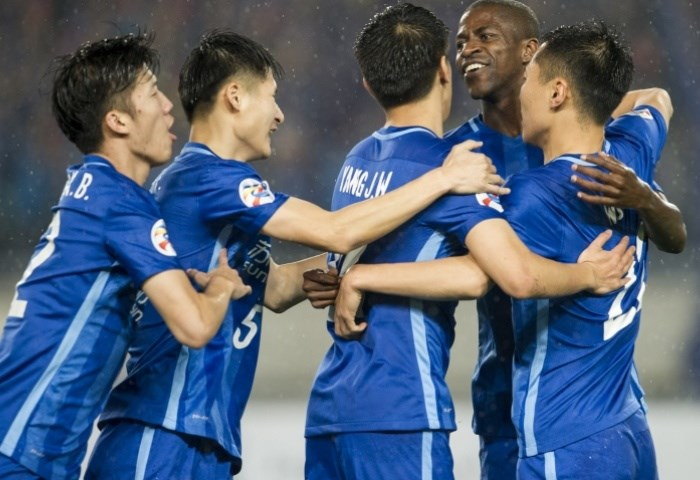 Jiangsu Suning players celebrate a goal against Becamex Binh Duong in an AFC Champions League match on April 20. Photo credit: AFC