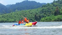 Tourists on a banana boat in Madagui. Photo credit: Madagui Tourism Area