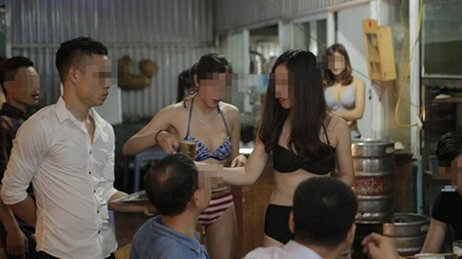 An image posted online shows women in bikinis serving beer at a restaurant in Hanoi