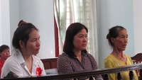 Nguyen Thi Thuy Trang (L) , Pham Thi Hanh (C) and Vo Thi Beo stand the trial on June 9. Photo: Mai Tram