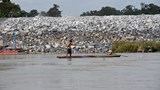 A fisherman in front of the Don Sahong cofferdam in Laos. Photo credit: International Rivers