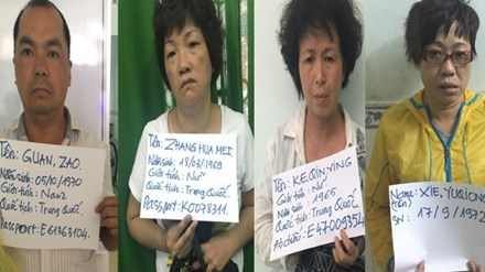 Four Chinese suspects shown in a photo supplied by the police