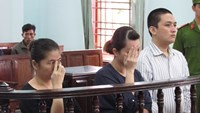 Mai Thi Be Thuy (L), Tat Cam Linh (C) and Luu Tuan Khanh stand the trial in Can Tho City on June 28, 2016. Photo credit: Zing News
