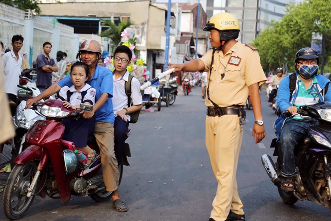 A motorbike driver being pulled over on a street in Ho Chi Minh City. Photo: Doc Lap