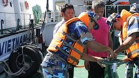 Vietnamese coast guard personnel inspect the Thai ship they caught smuggling diesel on July 22. Photo credit: VOV