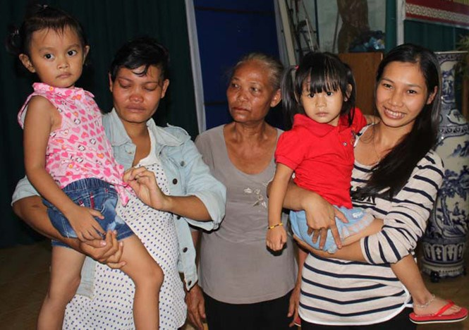 The two mothers in Binh Phuoc Province with their biological daughters in a photo taken on July 25, 2016. Photo: Tieu Thien