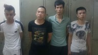 Four arrestees at the police station. Photo credit: CAND