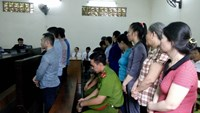 The defendants stand the trial in Ho Chi Minh City on August 23. Photo: Phan Thuong