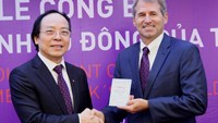 Do Minh Phu, TPBank chairman, grants shareholder book to IFC's representative. Photo credit: TPBank
