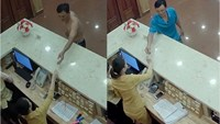 Images show the suspect getting the key to the room at the reception. Photo credit: Tuoi Tre