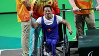 Le Van Cong celebrates after lifting 183kg to break a world record at the 2016 Rio Paralympic. Photo credit: Reuters