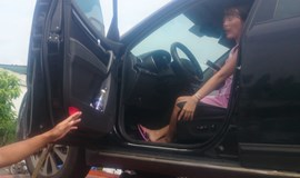 Uncooperative woman stays in car, towed to police station