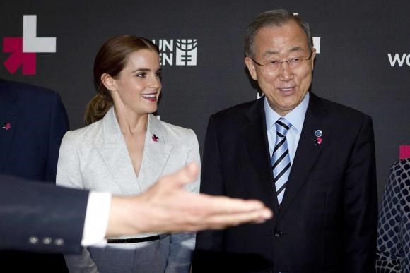 Actress Emma Watson (L) and United Nations Secretary General Ban Ki-moon are shown the way to the exit following a photo opportunity promoting the HeForShe campaign in New York September 20, 2014. Photo: Reuters