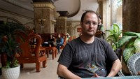 Karl Werner, 37, speaking to Thanh Nien Friday at the Tran Vinh Hotel in Bac Lieu City. Attempts to broker a reunion between Ela Herawati and her daughter broke down due to a lack of trust on both sides. Photo: Calvin Godfrey