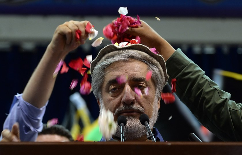 Afghan presidential candidate Abdullah Abdullah is showered with rose petals by supporters as he prepares to speak at a rally in Kabul on July 8, 2014. Presidential candidate Abdullah Abdullah claimed victory on July 8 in Afghanistan's disputed election,