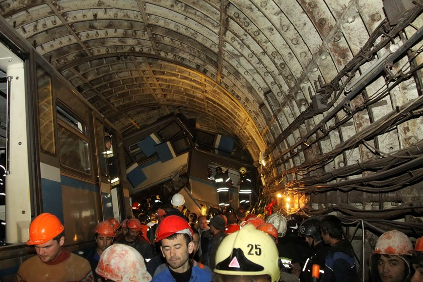 Members of the emergency services work at the site of an accident on the subway in Moscow July 15, 2014. Photo: Reuters/Press Service of Russian Emergencies Ministry of Moscow Region