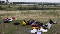 Australia seeks to secure MH17 remains as Abbott deploys police
