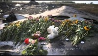 Crews clear debris, bodies from MH17 crash site