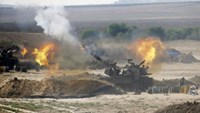 Israel strikes house of Hamas Gaza leader, digs in for long fight