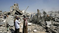 Palestinians collect usable stuff inside the debris during 72-hour humanitarian ceasefire in Rafah, Gaza.