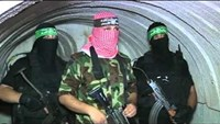 Hamas fighters show defiance in Gaza tunnel tour