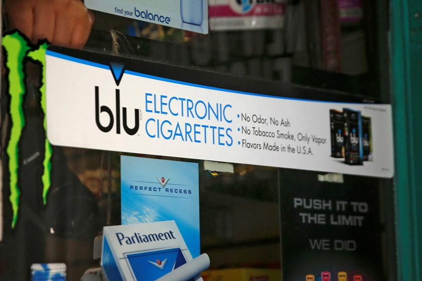 An advertisement for the e-cigarette brand blu is seen on the window of a store in New York in this file photo taken May 27, 2014. The World Health Organization wants governments to crackdown on the smoke-free cigarette known as the e-cigarette. Photo: Re