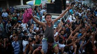 Gaza celebrates as Palestinian president announces ceasefire