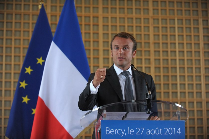 Newly appointed Economy Minister Emmanuel Macron, a 36-year-old ex-Rothschild banker and architect of the president's economic policy, talks during a handover ceremony in Paris at the Economy Ministry. Photo: AFP
