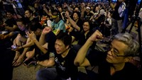 Black-clad pro-democracy protesters march in Hong Kong