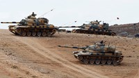 Syrian war rages on multiple fronts as Turkish tanks reinforce border