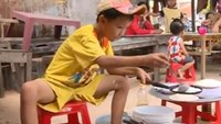 Banh xeo boy captures Vietnam's heart