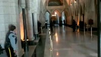 A still image captured from video footage by the Globe and Mail newspaper shows police officers responding to shooting attacks inside the Centre Block of the Parliament buildings in Ottawa, Ontario October 22, 2014.