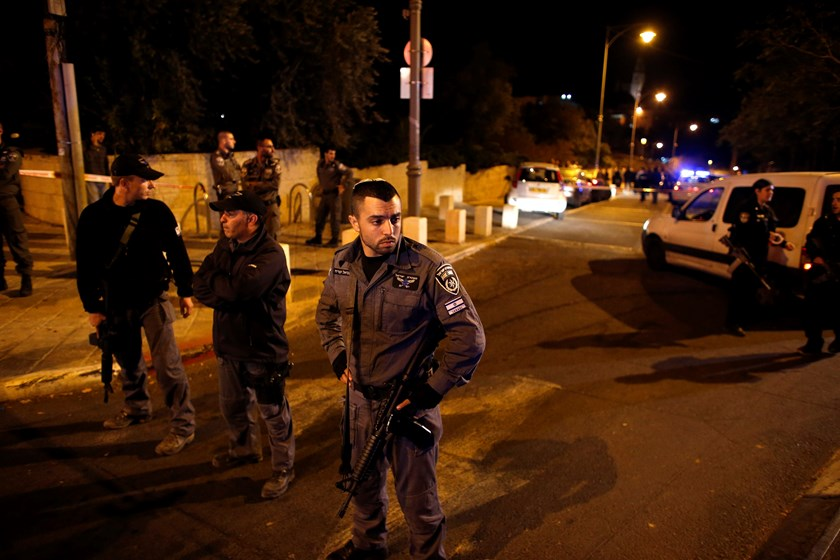 Israeli security personals secure an area in Jerusalem where an Israeli far-right activist was shot and wounded, October 29, 2014. Photo: Reuters/Ronen Zvulun