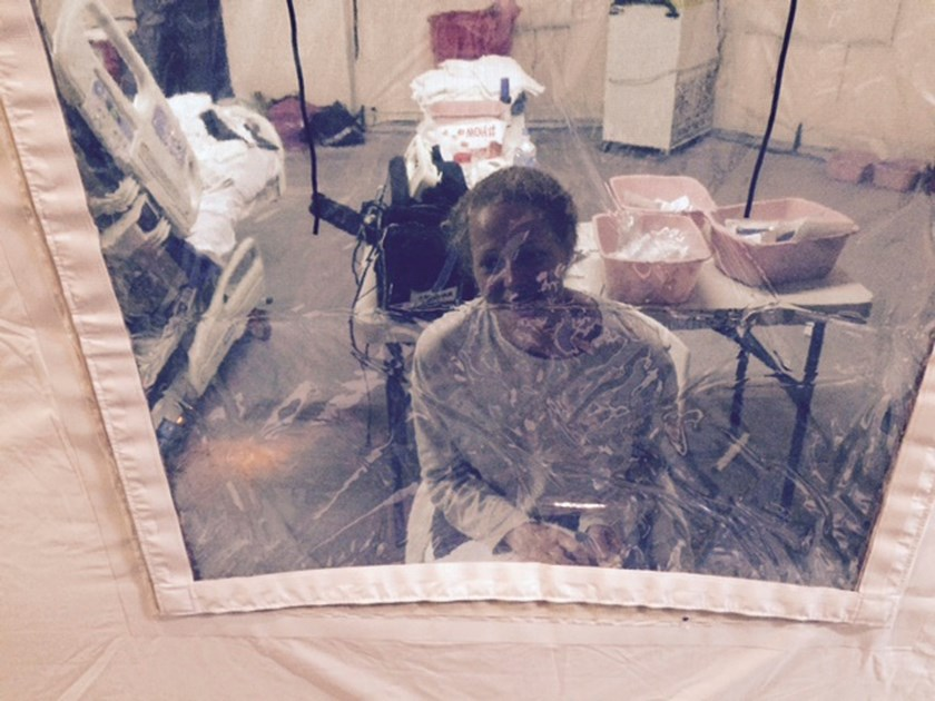 Kaci Hickox, a nurse who arrived in New Jersey on October 24 after treating Ebola patients in West Africa, speaks to her lawyer Norman Siegel from a hospital quarantine tent in Newark, New Jersey, October 26, 2014, in a photo provided by attorney Steve Hy