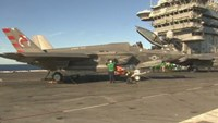 Lockheed F-35 fighter jets make smooth landing at sea in maiden flight