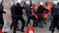 Cars upturned, smoke bombs fired amid clashes in Belgium over new government