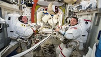 NASA astronauts Reid Wiseman (R) and Barry Wilmore work inside the International Space Station on October 1, 2014. Photo: Reuters/NASA/Handout