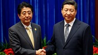 Frosty greeting between Xi and Abe