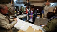 Election volunteers count the votes after polls closed in a symbolic independence vote in Barcelona, November 9, 2014. Photo: Reuters/Paul Hanna
