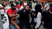 Protesters attack police as anger boils in Mexico over 43 missing students