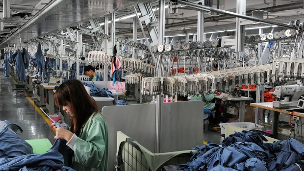 Workers sew in a clothing factory in Bozhou, Anhui province. Photo: AFP/Getty Images