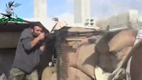 Syrian rebels fight on two fronts - Islamic State and government