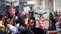Thousands protest the government of Haiti's President Martelly