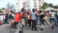 Violence breaks out as Haitians rally to oust Martelly's government
