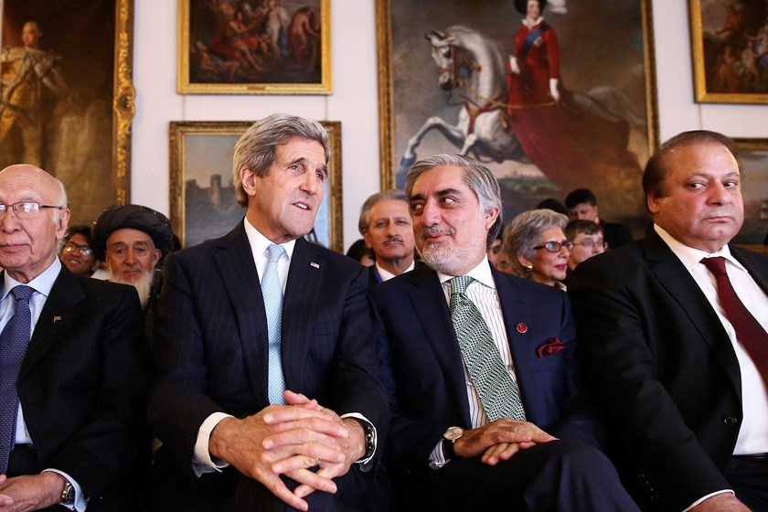 U.S. Secretary of State John Kerry (2nd L) speaks with Afghanistan's Chief Executive Abdullah Abdullah (2nd R) during the London Conference on Afghanistan December 4, 2014 The United States and Britain pledged on Thursday to support Afghanistan's new unit